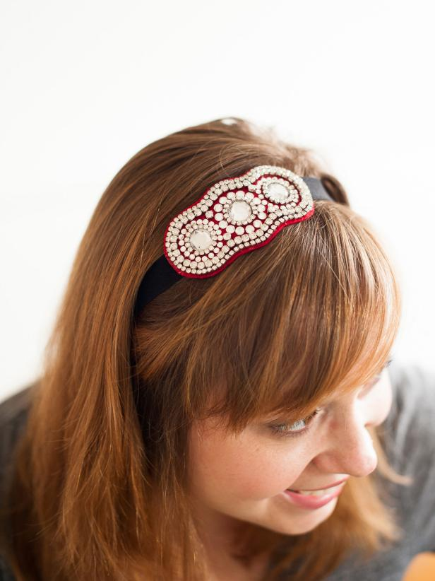 Woman Wearing Black and Red Rhinestone Headband
