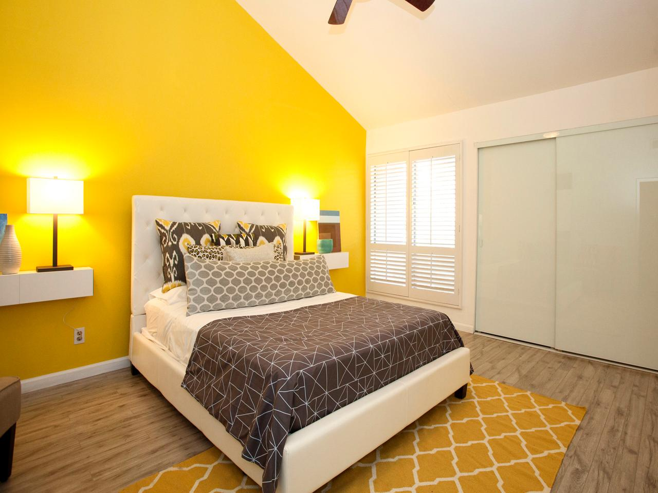 Contemporary Bedroom With Bright Yellow Accent Wall | HGTV