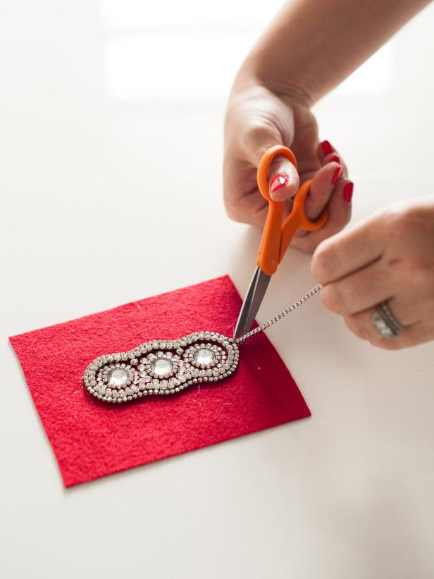 When you've completed the sparkling design for your headband, remove the excess rhinestone trim.