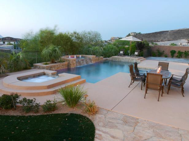 Backyard With Large Patio and Serene Pool With Elevated Spa