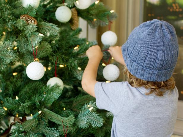 Loop twine through the pin and hang your finished ornaments on the tree.