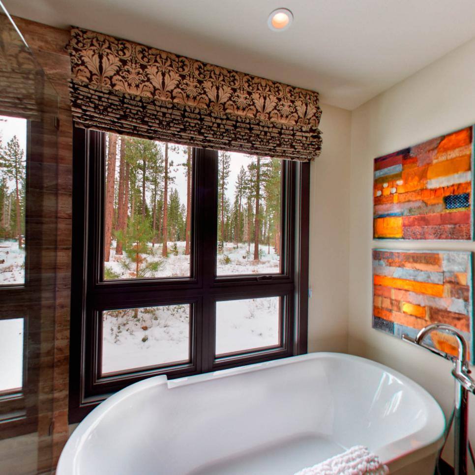 Transitional Bathroom With Freestanding Tub and Colorful Artwork