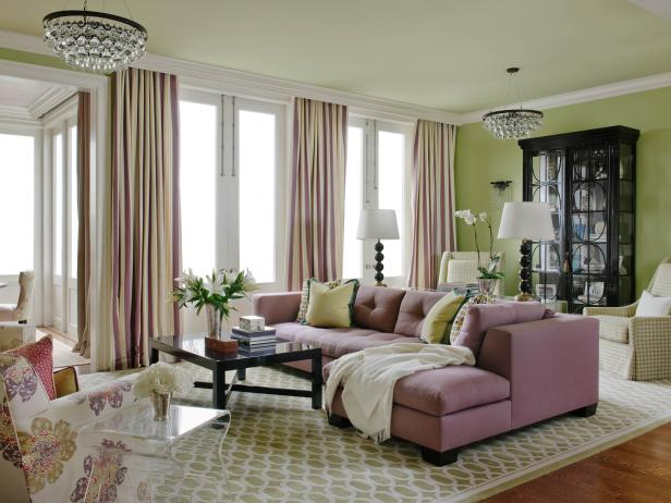 Green Living Room With Pink Sofa and Chandeliers