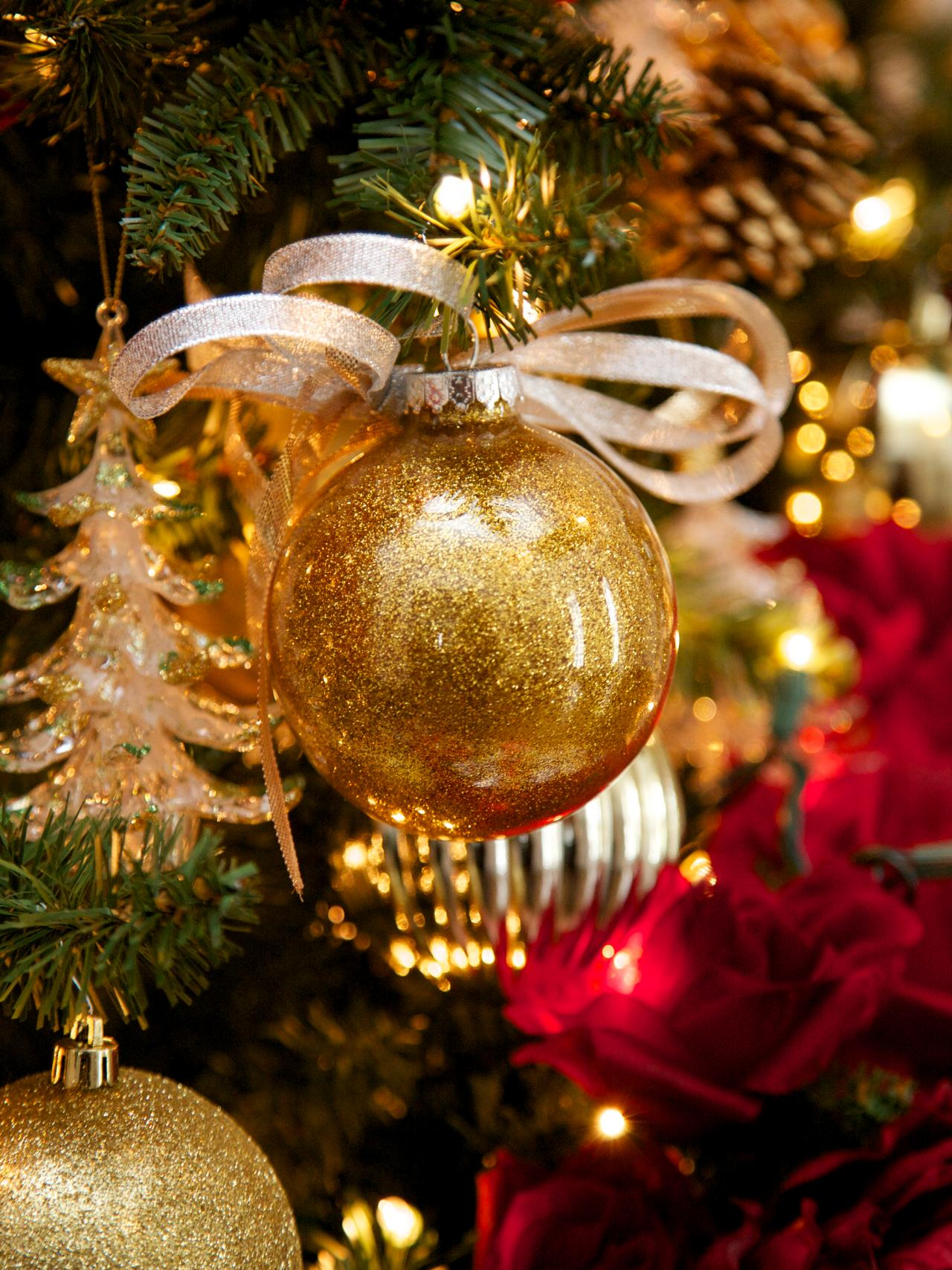 Make glitter glass ball ornaments hgtv for The christmas decorations