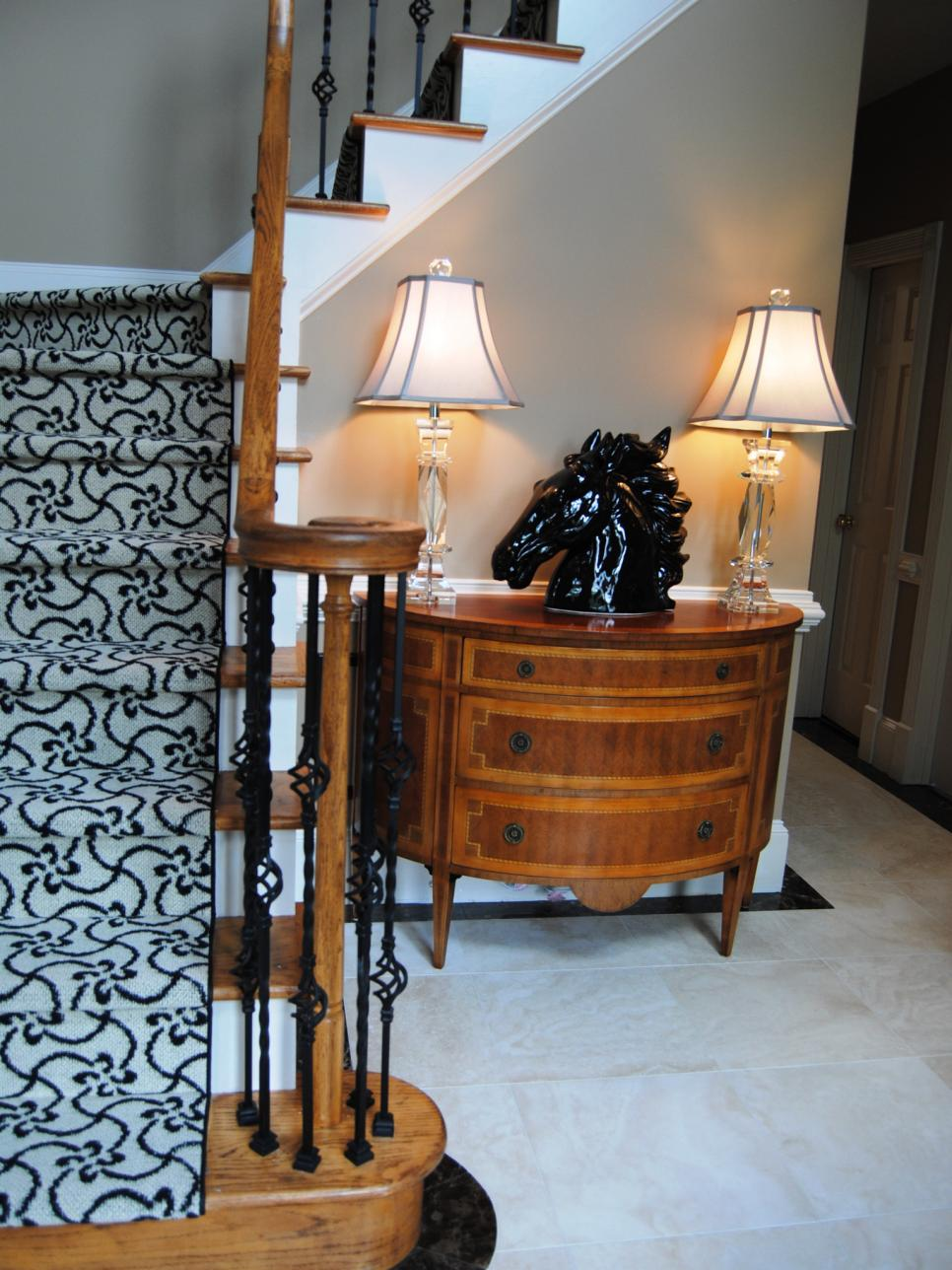Black and White Foyer With Patterned Carpet Staircase