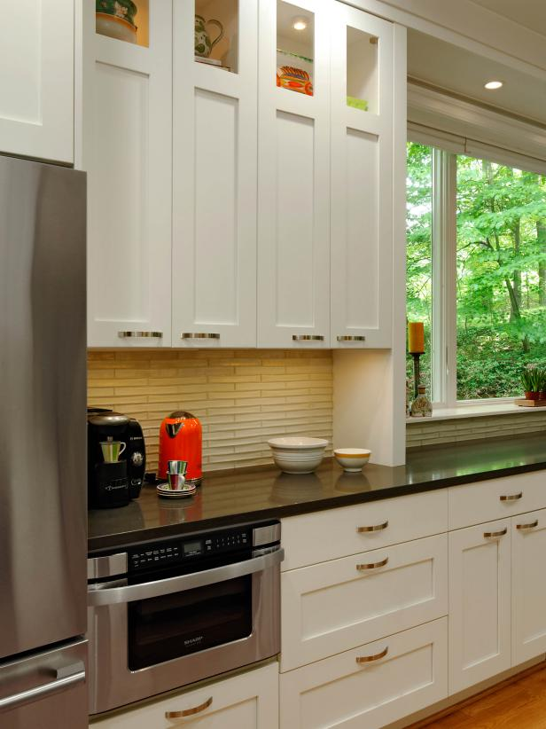 White Galley Kitchen With Black Quartz Countertop Hgtv