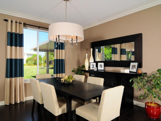 Neutral Dining Space With Striped Curtains and Contemporary Chandelier