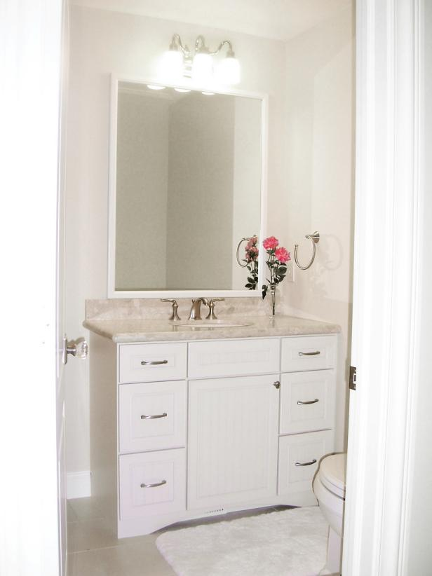 Traditional Beige Powder Room With Shaker-Style Vanity