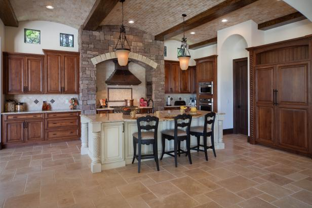 Tuscan Kitchen With Barrel Ceiling and Stone Hearth