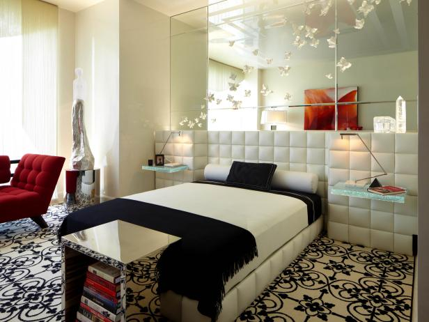 White Bedroom With Mirror Wall and Textured Headboard