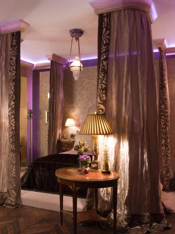 Traditional Bedroom With Canopy Bed and Purple Hues