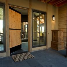 Rustic Front Porch With Pine Door