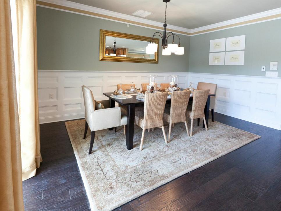 Green Dining Room with White Wainscoting and Neutral Furniture