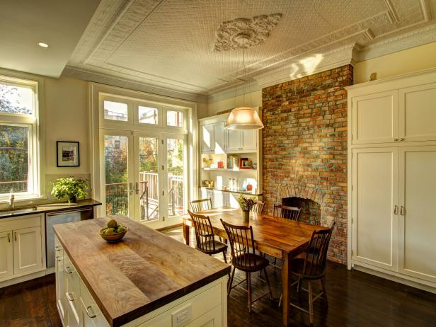 Cream Country Kitchen with Butcher Block Island and Brick Fireplace