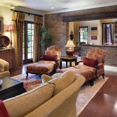 Tuscan Living Room With Brick Accent Wall Is Cozy Inviting