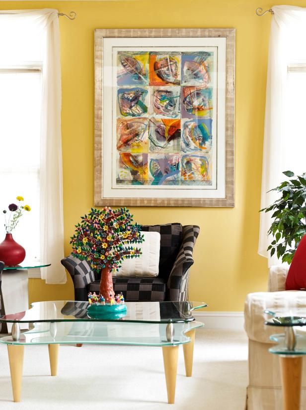 Yellow Living Room With Brown Geometric Chair and Contemporary Art