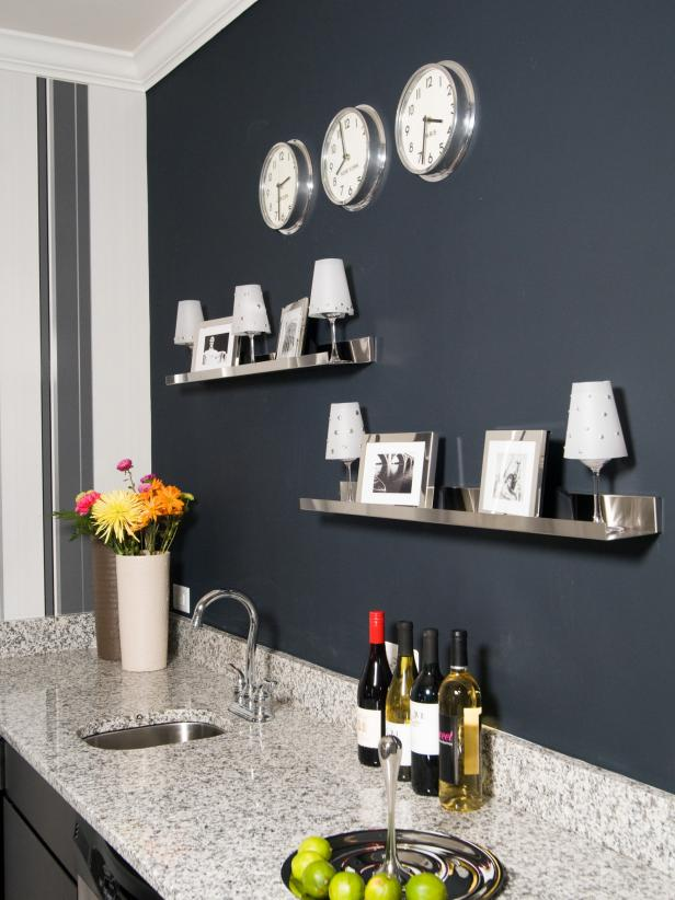 Dark Gray Wall With Stainless Steel Shelves and Wet Bar