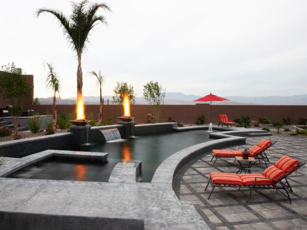 Modern Pool With Waterfall And Fire Pits Hgtv