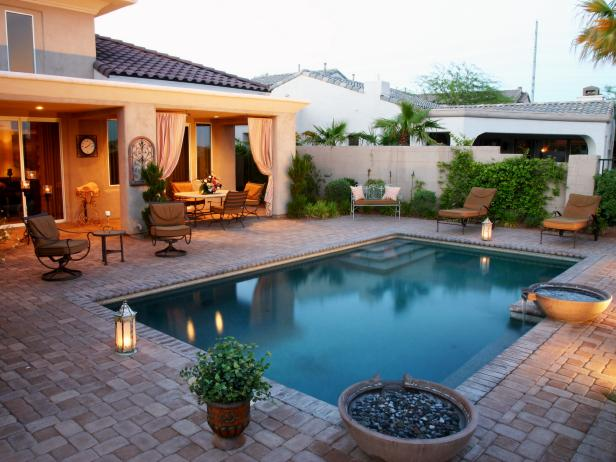 Traditional Pool With Stone Patio Pavers and Dining Area