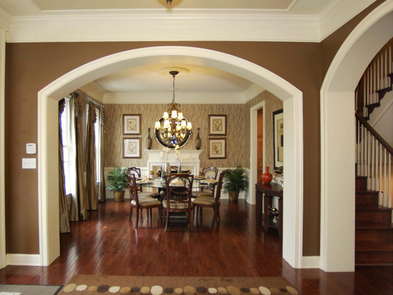 Neutral Traditional Dining Room With Dramatic Archway | HGTV