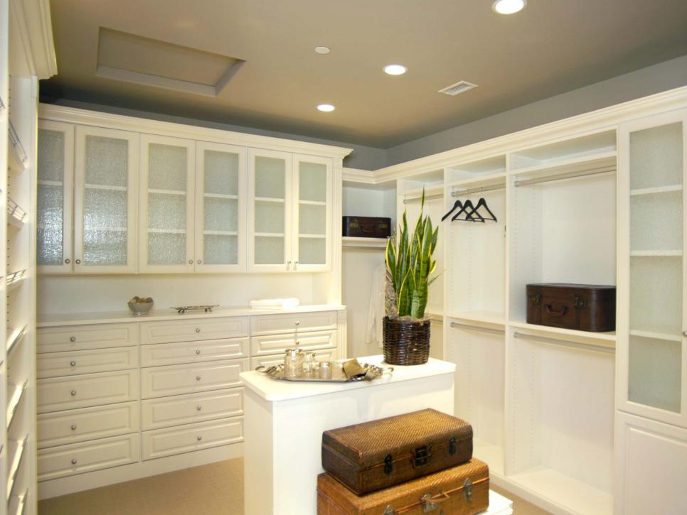 Walk-In Closet With Built-In Storage, Recessed Lighting, Houseplant