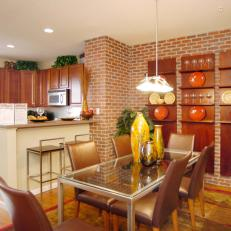 Eclectic Dining Room With Brick Accent Wall