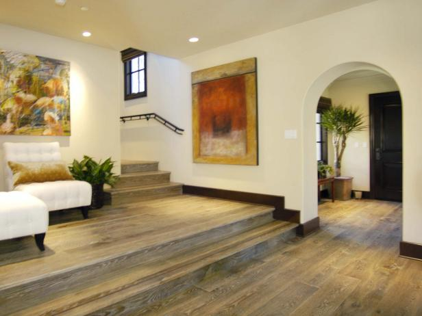 White Mediterranean Foyer With Wood Flooring and Archway