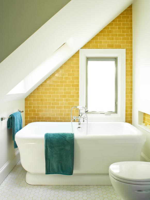 Yellow-Tiled Angled Bathroom Wall With Hexagonal Floors
