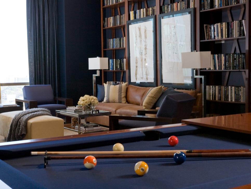 Library with pool table and book shelves