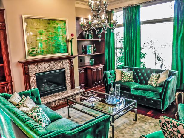 Living Room with Green Velvet Couches and Curtains