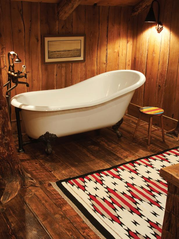 Claw Foot Bathtub and Navajo Rug in Rustic Cabin Kids' Bathroom