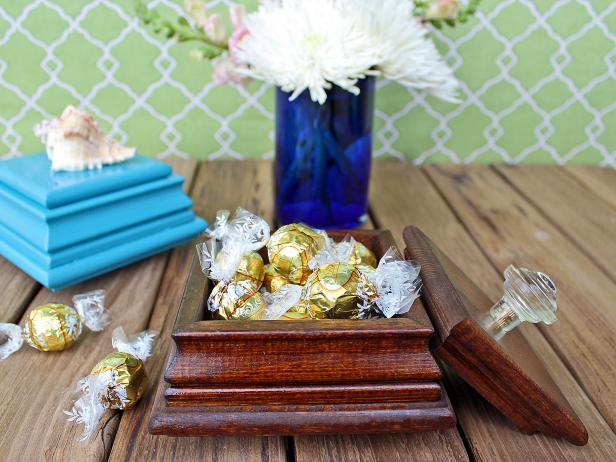 "Turn inexpensive fence-post caps into a pretty jewelry or gift box. By itself, the box makes a thoughtful birthday, Mother's Day or holiday gift. Fill it with sweet treats or a small trinket for a handmade gift they won't soon forget. Get crafting to make your own with our <a target=""blank"" href=""http://www.hgtv.com/design/make-and-celebrate/handmade/easy-to-craft-handmade-jewelry-box"">step-by-step instructions</a>."