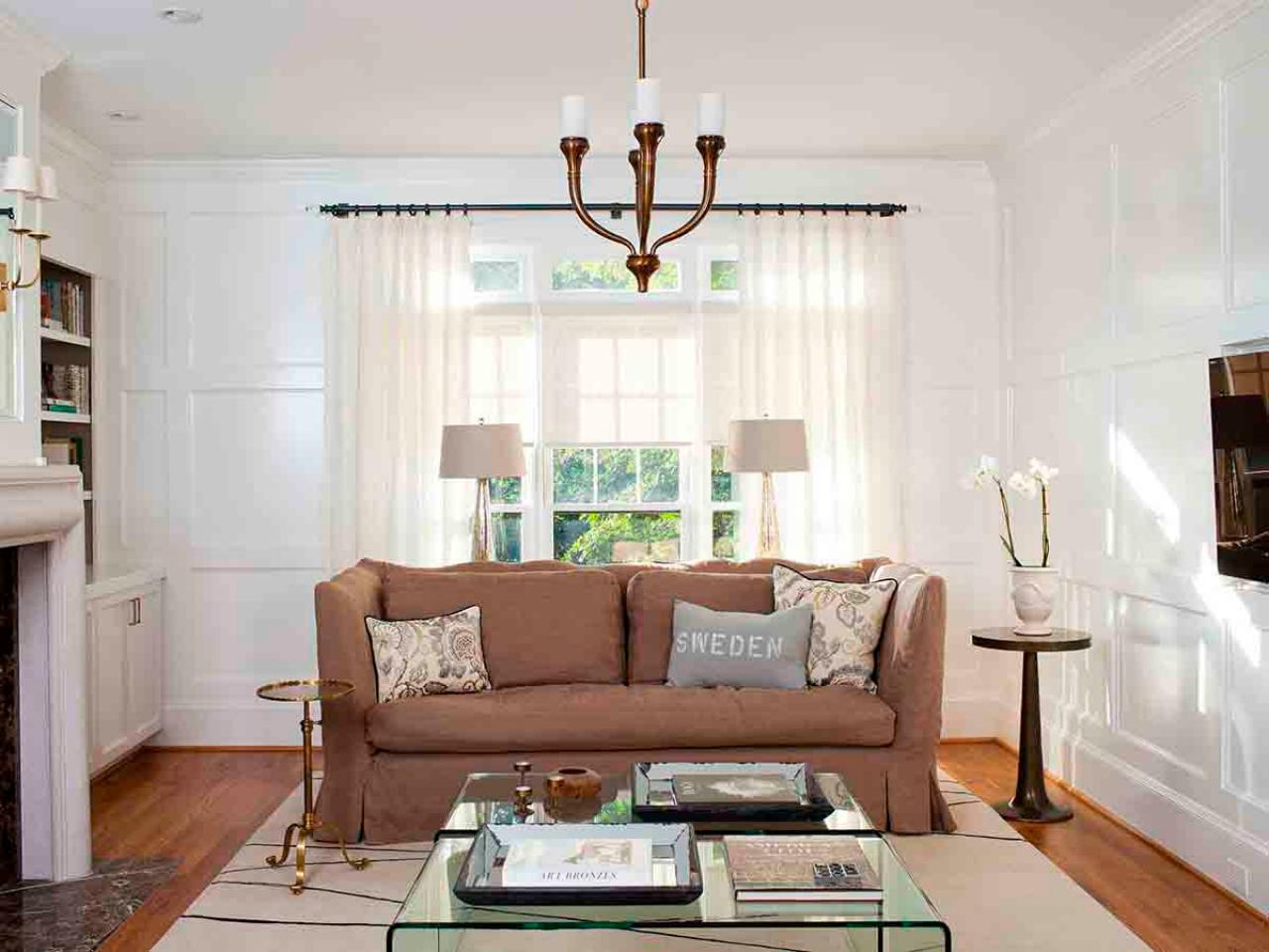 White Transitional Living Room With Tan Sofa and Bronze ...