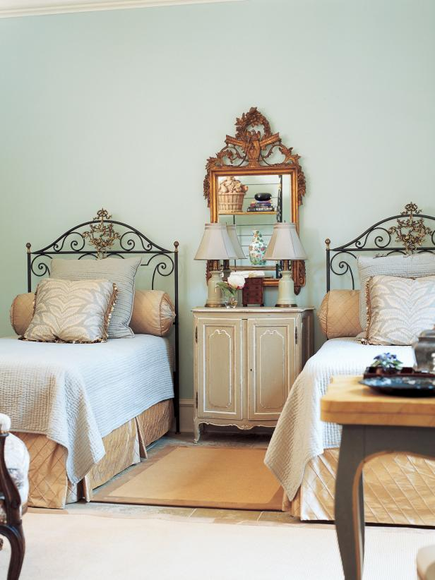 Twin Bed Guest Room with Golden Accents