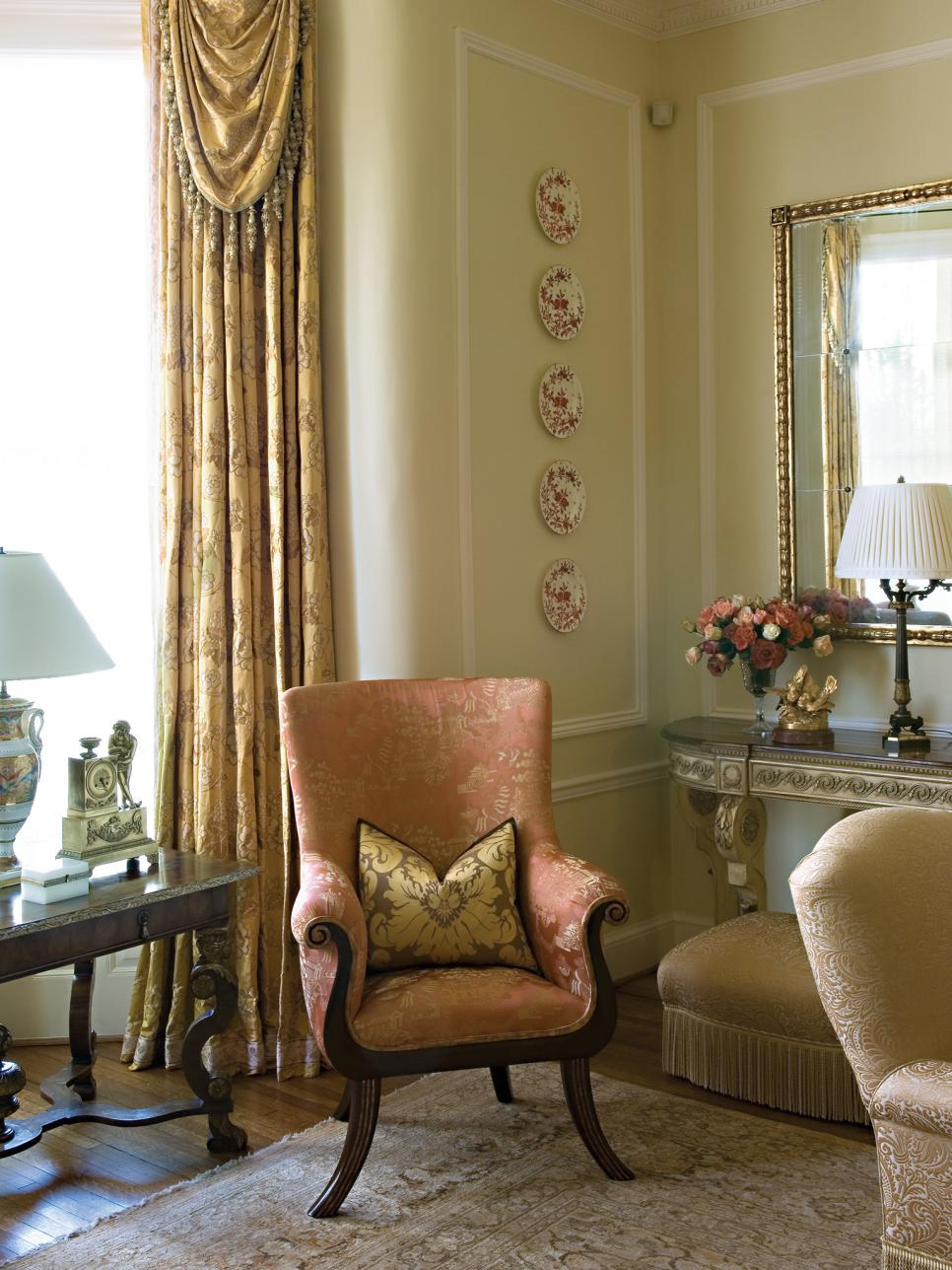 Corner of Sitting Room With Plate Collection & Peach Armchair