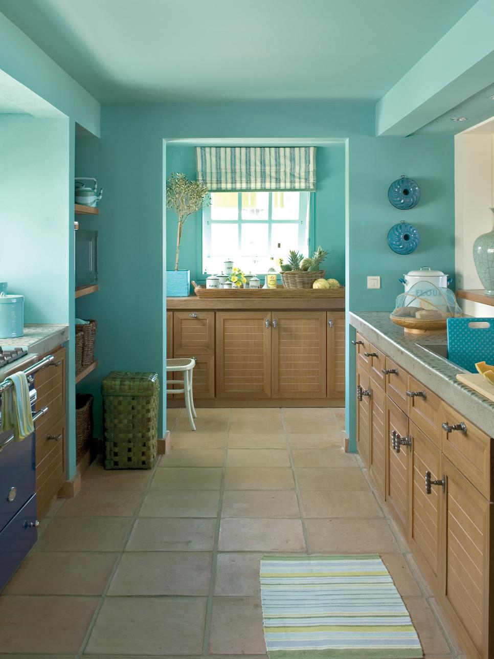Tropical Blue Galley Kitchen With Tile Floor
