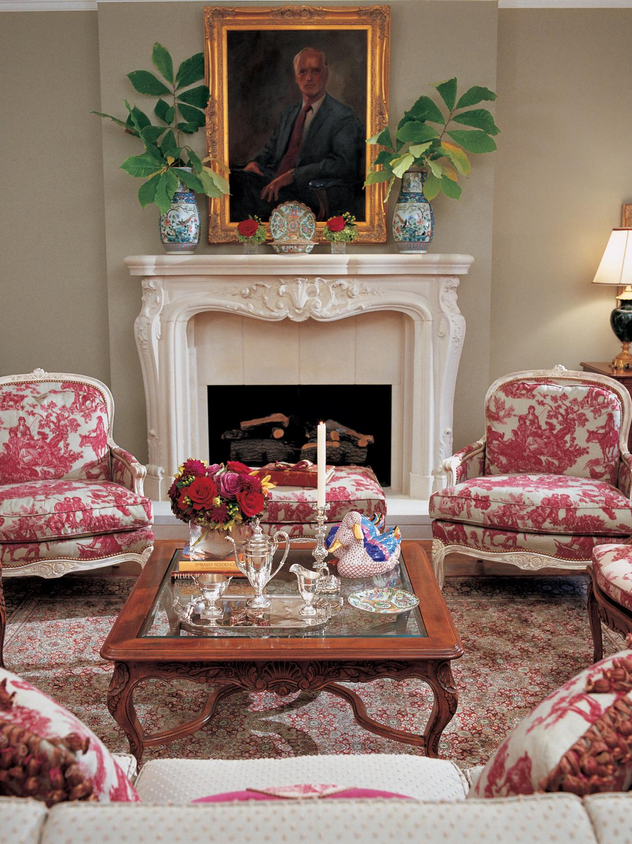 Living room with limestone mantel and red toile chairs hgtv - Pictures of decorated living rooms ...