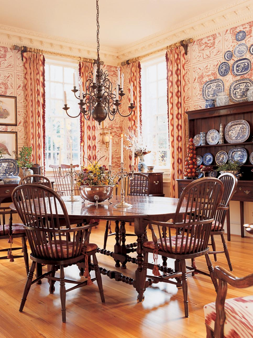 Dining Room With Toile Wallpaper, Brass Chandelier, Plate Collection