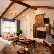 Living Room With White Stone Wall