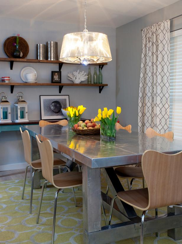 Gray Dining Room With Stainless Steel Dining Table and Shelves