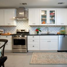 Contemporary White Kitchen With Subway Tile Backsplash