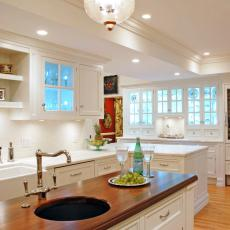 Traditional White Kitchen With Cherry Wood Island
