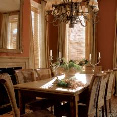 Transitional Dining Room With Chandelier