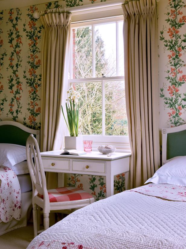 shabby chic bedroom with a desk area sandwiched between twin beds