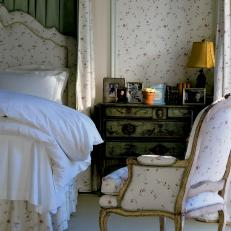 Country Bedroom With White Floral Upholstery