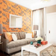 Eclectic Living Room With Neutral Sofa and Bold Floral Wallpaper