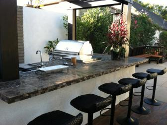 Contemporary Outdoor Kitchen With Black Barstools