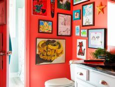 Red Kids' Bathroom With Framed Hand-Drawn Artwork