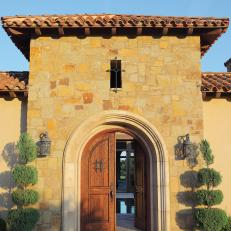 Arched Front Doors on Mediterranean House