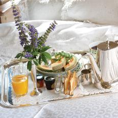 Silver Breakfast Tray With Teapot on White Comforter